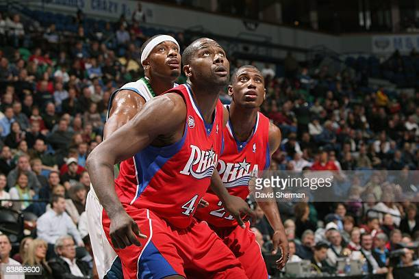 Elton Brand and Thaddeus Young of the Philadelphia 76ers box out Craig Smith of the Minnesota Timberwolves during the game on November 19 2008 at the...