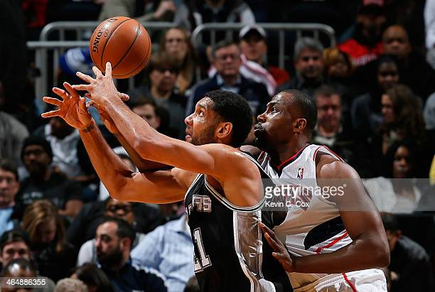 Elton Brand of the Atlanta Hawks fouls Tim Duncan of the San Antonio Spurs at Philips Arena on January 24 2014 in Atlanta Georgia NOTE TO USER User...