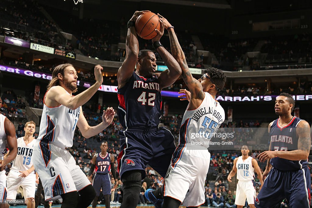 Elton Brand #42 of the Atlanta Hawks makes a play for the ball during the game against the Charlotte Bobcats at the Time Warner Cable Arena on March 17, 2014 in Charlotte, North Carolina.