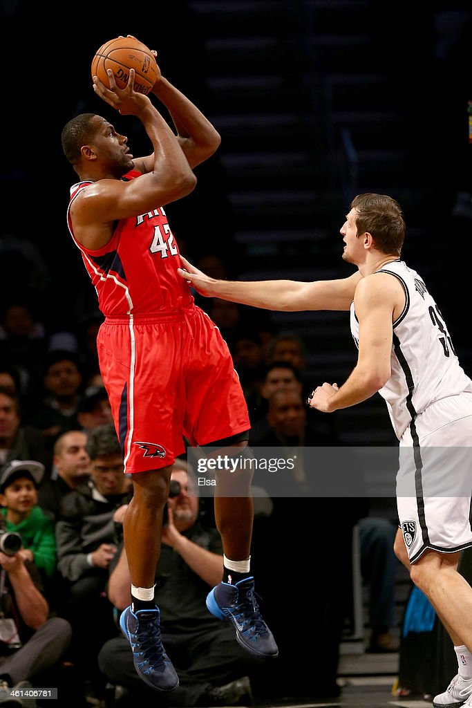 Elton Brand #42 of the Atlanta Hawks takes a shot as Mirza Teletovic #33 of the Brooklyn Nets defends at the Barclays Center on January 6, 2014 in the Brooklyn borough of New York City.The Brooklyn Nets defeated the Atlanta Hawks 91-86.