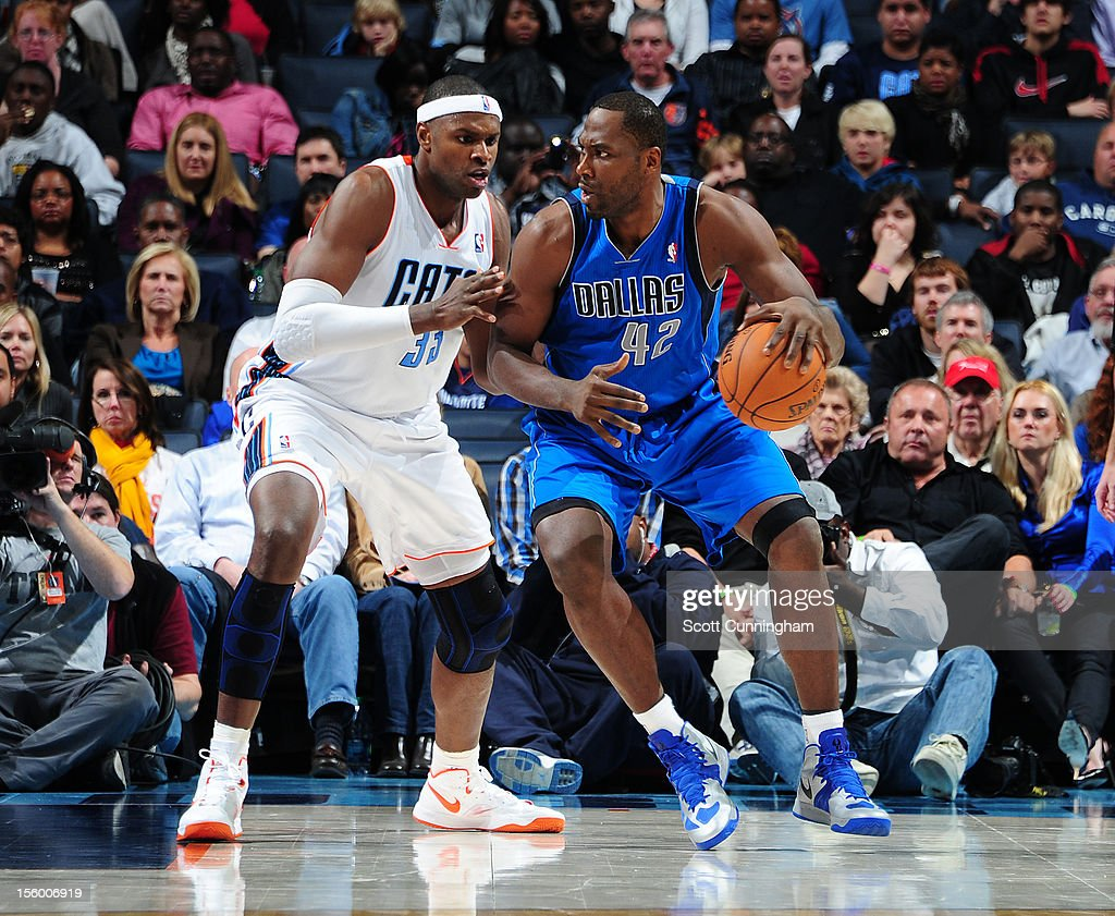 Elton Brand #42 of the Dallas Mavericks drives to the basket vs Brandan Haywood # 33 of the Charlotte Bobcats at Time Warner Cable Arena on November 10, 2012 in Charlotte, North Carolina.