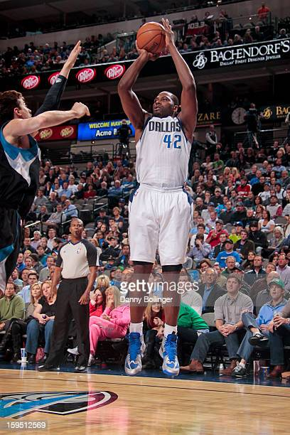 Elton Brand of the Dallas Mavericks shoots against Alexey Shved of the Minnesota Timberwolves on January 14 2013 at the American Airlines Center in...