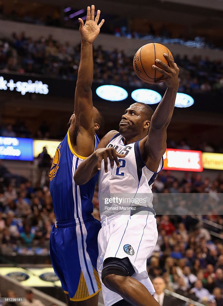 Elton Brand #42 of the Dallas Mavericks takes a shot against Carl Landry #7 of the Golden State Warriors at American Airlines Center on February 9, 2013 in Dallas, Texas.
