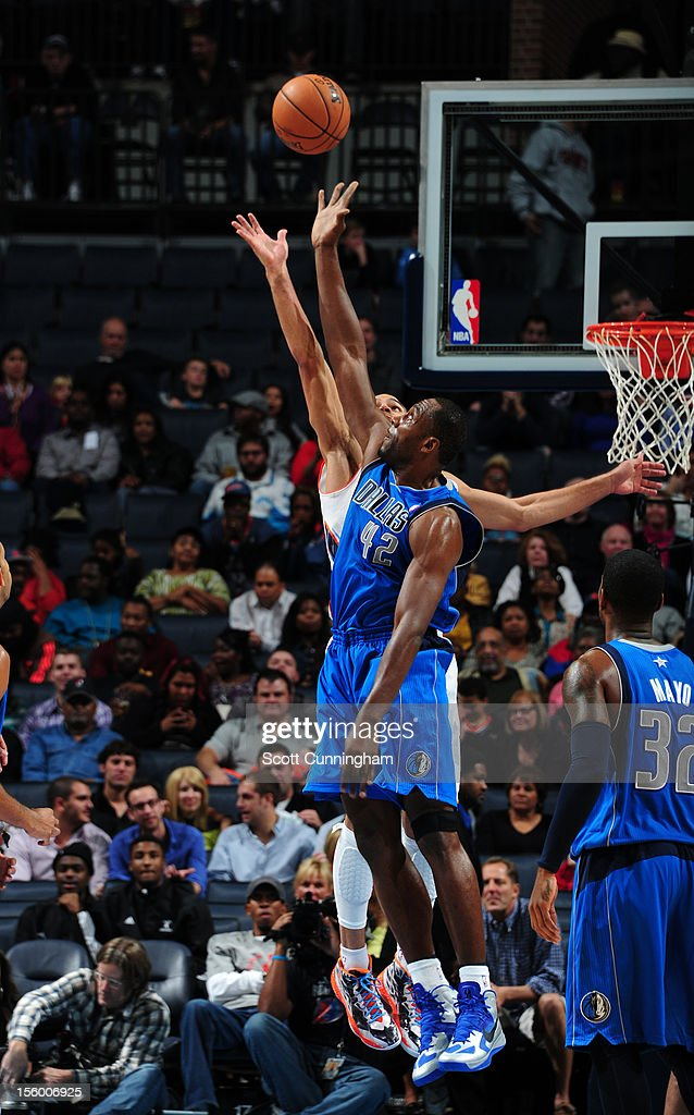 Elton Brand #42 of the Dallas Mavericks trys to block the shot of a Charlotte Bobcats player at Time Warner Cable Arena on November 10, 2012 in Charlotte, North Carolina.