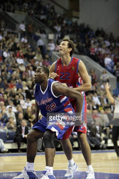 Elton Brand of the Los Angeles Clippers and Tomas Van Den Spiegel of CSKA compete fro position during their game at Universal Sports Hall CSKA during...
