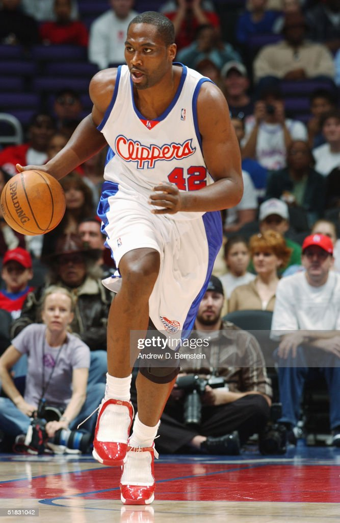 Elton Brand #42 of the Los Angeles Clippers brings the ball upcourt during the game against the Houston Rockets at Staples Center on November 20, 2004 in Los Angeles, California. The Rockets won in overtime 91-86.