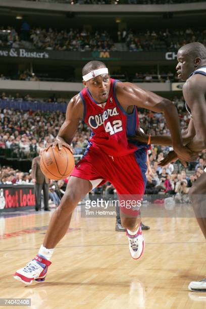 Elton Brand of the Los Angeles Clippers drives against DeSagana Diop of the Dallas Mavericks at American Airlines Center on April 9 2007 in Dallas...