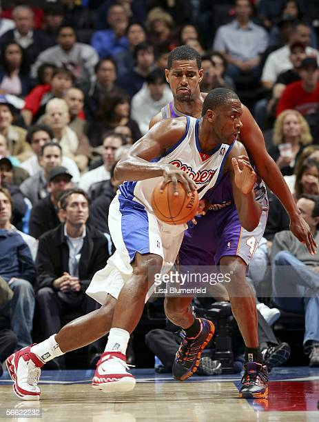 Elton Brand of the Los Angeles Clippers drives to the basket under pressure from Kurt Thomas of the Phoenix Suns on January 18 2006 at Staples Center...