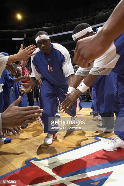 Elton Brand of the Los Angeles Clippers is greeted by teammates during introductions before the game against the New York Knicks at Staples Center on...