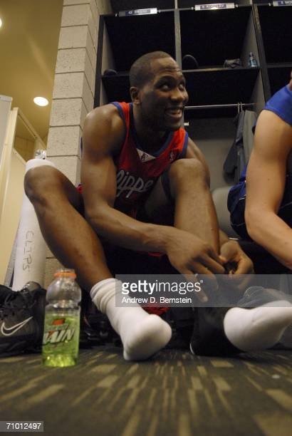 Elton Brand of the Los Angeles Clippers laces up his shoes in the locker room before the game against the Phoenix Suns in game seven of the Western...