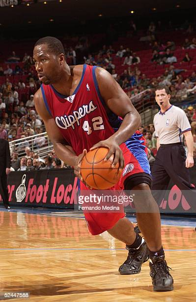 Elton Brand of the Los Angeles Clippers moves the ball against the Orlando Magic during a game at TD Waterhouse Centre on February 15, 2005 in...