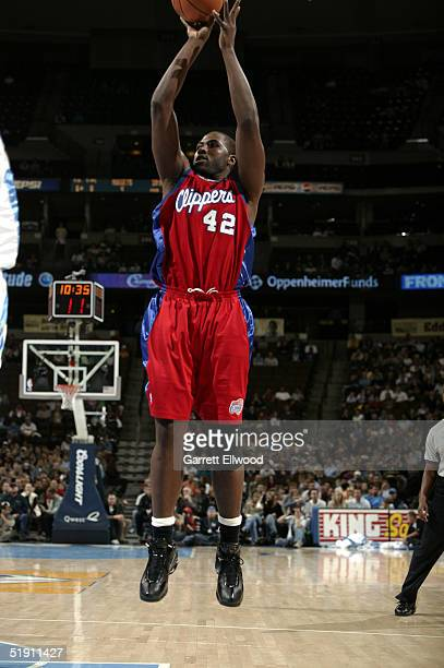 Elton Brand of the Los Angeles Clippers shoots against the Denver Nuggets on January 3 2005 at Pepsi Center in Denver Colorado NOTE TO USER User...
