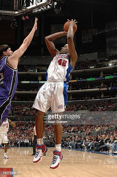 Elton Brand of the Los Angeles Clippers shoots over Brad Miller of the Sacramento Kings at Staples Center on April 15 2007 in Los Angeles California...