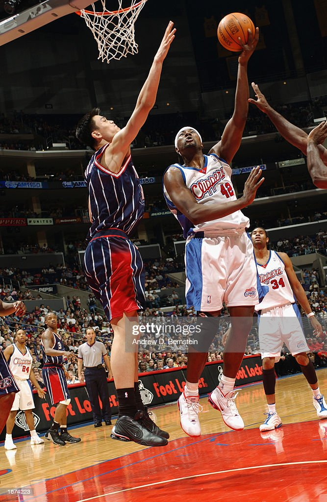 Elton Brand #42 of the Los Angeles Clippers shoots over Yao Ming #11 of the the Houston Rockets during the game at Staples Center on November 24, 2002 in Los Angeles, California. The Clippers won 90-89.