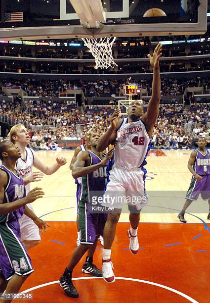 Elton Brand of the Los Angeles Clippers throws up a shot during the NBA game between the Los Angeles Clippers and the Milwaukee Bucks at the Staples...