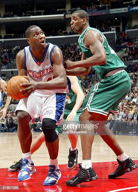 Elton Brand of the Los Angeles Clippers tries to get a shot up under pressure from Mark Blount of the Boston Celtics in the first half on December 13...
