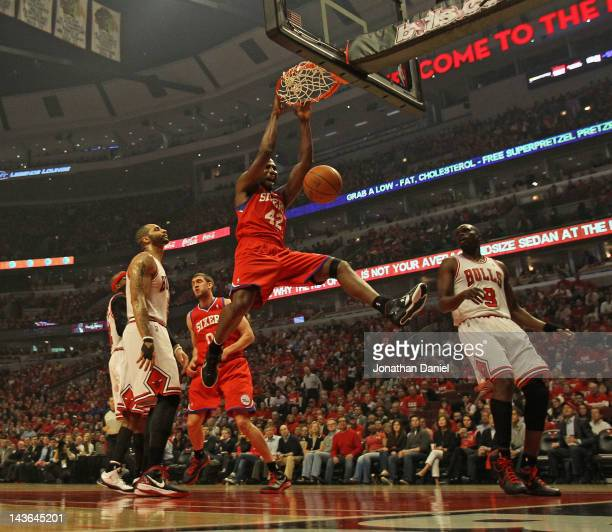 Elton Brand of the Philadelphia 76ers dunks the ball over Carlos Boozer and Loul Deng of the Chicago Bulls in Game Two of the Eastern Conference...