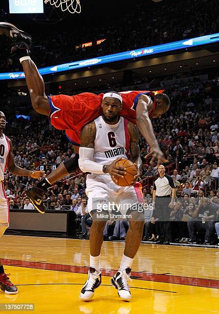 Elton Brand of the Philadelphia 76ers fouls LeBron James of the Miami Heat during a game at American Airlines Arena on January 21 2012 in Miami...