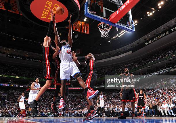 Elton Brand of the Philadelphia 76ers rebounds against Zydrunas Ilgauskas and Chris Bosh of the Miami Heat in Game Three of the Eastern Conference...