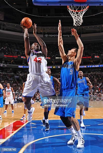 Elton Brand of the Philadelphia 76ers shoots against Yi Jianlian of the Dallas Mavericks on February 17 2012 at the Wells Fargo Center in...