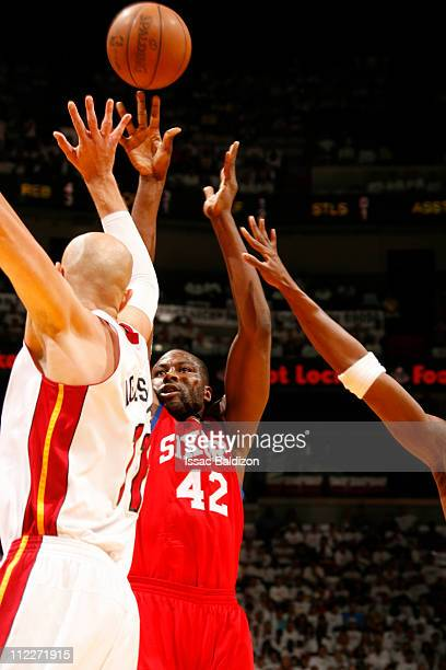 Elton Brand of the Philadelphia 76ers shoots against Zydrunas Ilgauskas of the Miami Heat in Game One of the Eastern Conference Quarterfinals in the...