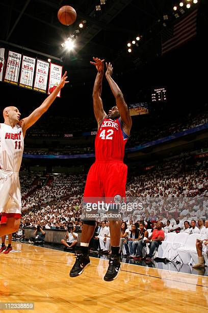 Elton Brand of the Philadelphia 76ers shoots against Zydrunas Ilgauskas of the Miami Heat in Game Two of the Eastern Conference Quarterfinals in the...
