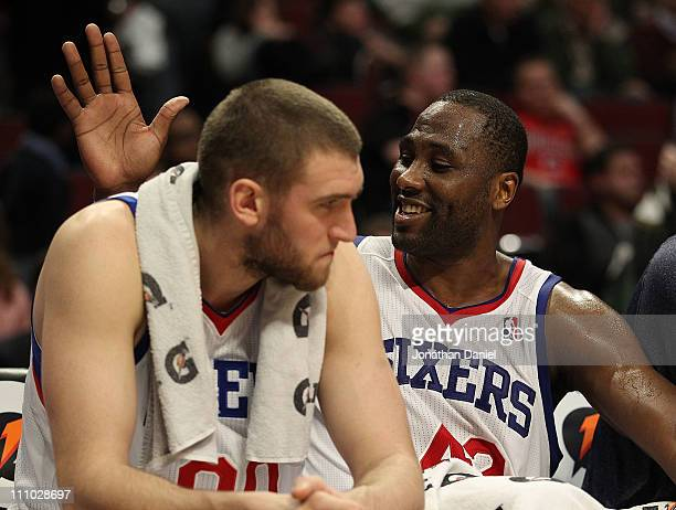 Elton Brand of the Philadelphia 76ers slaps teammate Spencer Hawes on the back at the end of a win over the Chicago Bulls at the United Center on...
