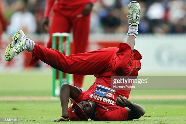 Elton Chigumbura of Zimbabwe fields during game two of the One Day International series between New Zealand and Zimbabwe at Cobham Oval on February 6...