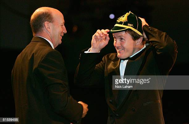 Elton Flatley is presented with his Wallaby Test Cap during the John Eales Medal Dinner at Wharf 8 October 23 2004 in Sydney Australia