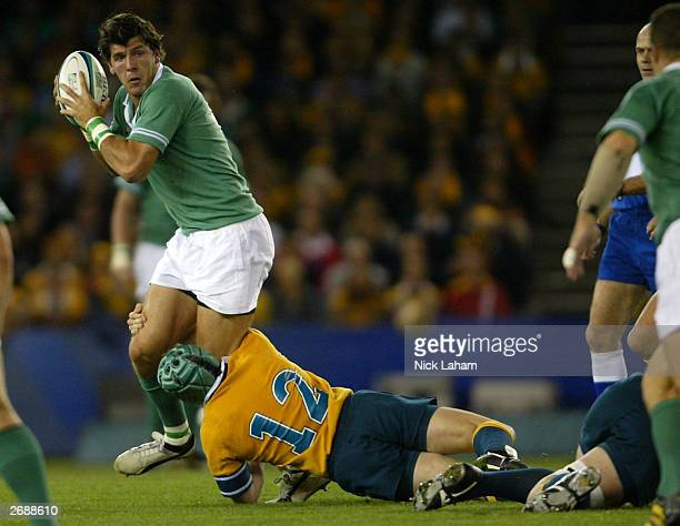 Elton Flatley of Australia hangs on the heels of Shane Horgan of Ireland during the Rugby World Cup Pool A match between Australia and Ireland at...