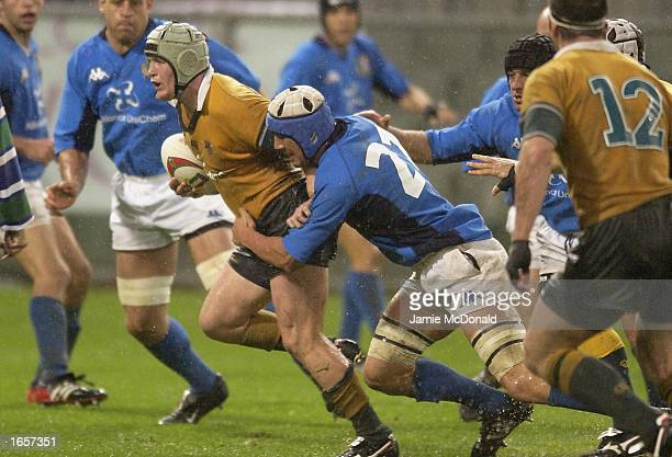 Elton Flatley of Australia is tackled by Gert Penns of Italy during the International Test Match between Italy and Australia at the Stadio Luigi...