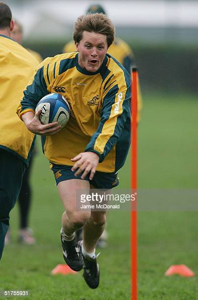 Elton Flatley of Australia runs with the ball during Australia training today at the Saut de Loup stadium on November 17 2004 in Paris France