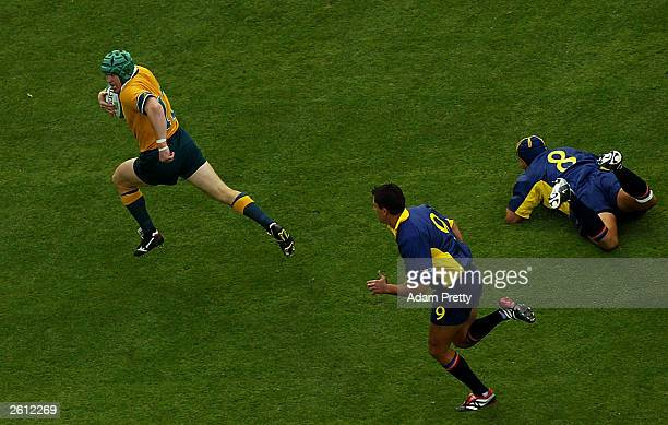 Elton Flatley of Australia scores the fastest ever World Cup try during the Rugby World Cup Pool A match between Australia and Romania at Suncorp...