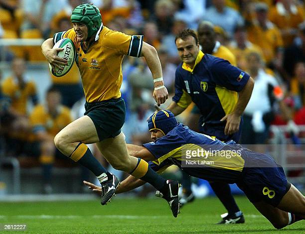 Elton Flatley of the Wallabies breaks the defence for a try during the Rugby World Cup Pool A match between Australia and Romania at Suncorp Stadium...