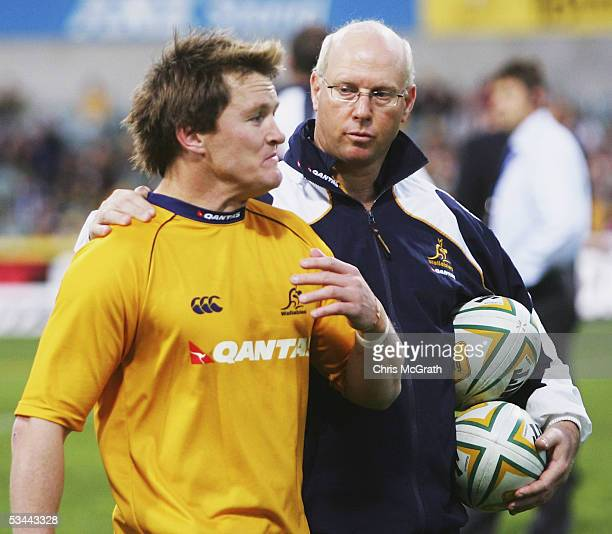 Elton Flatley of the Wallabies leaves the field with a team medical officer after suffering an injury prior to the start of the game at the...