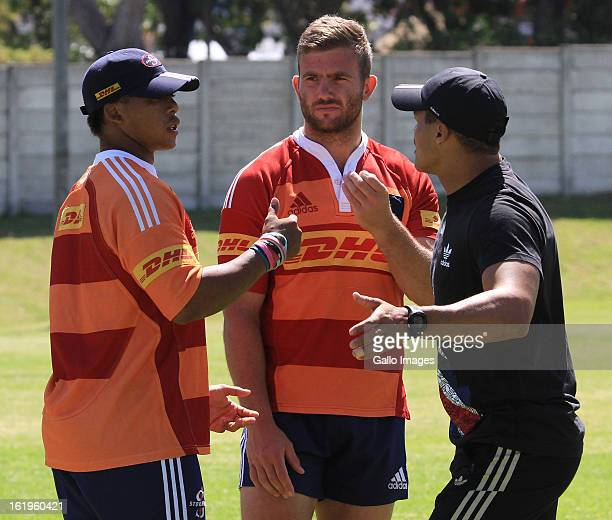 Elton Jantjies and Jaco Taute are joined in conversation by injured Juan de Jongh during the DHL Stormers training session and press conference at...