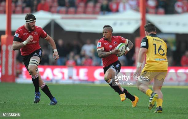 Elton Jantjies and Lourens Erasmus of Lions in action with Ricky Riccitelli of Hurricanes during the Super Rugby Semi Final match between Emirates...