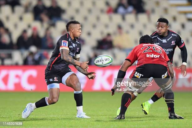 Elton Jantjies of the Lions passes the ball to Aphiwe Dyantyi of the Lions during the round 11 Super Rugby match between the Crusaders and Lions at...