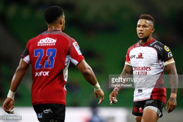 Elton Jantjies of the Lions speaks with Courtnall Skosan of the Lions during the round six Super Rugby match between the Rebels and the Lions at on...
