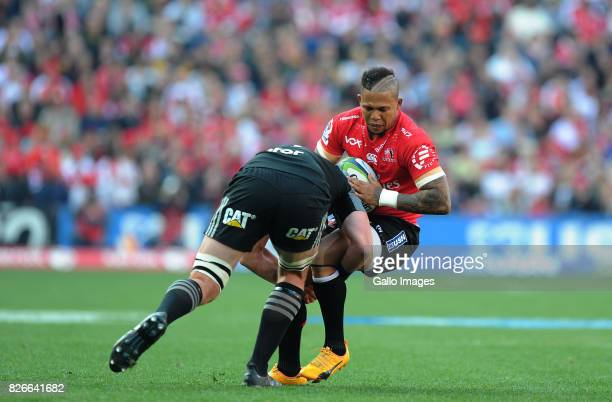 Elton Jatnjies of Lions is tackled by Kieren Read of Crusaders during the Super Rugby Final match between Emirates Lions and Crusaders at Emirates...