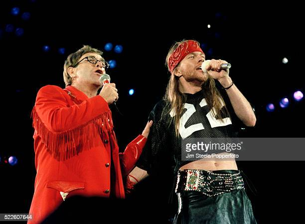 Elton John and Axl Rose of Guns N' Roses performing on stage during the Freddie Mercury Tribute Concert for Aids Awareness at Wembley Stadium in...