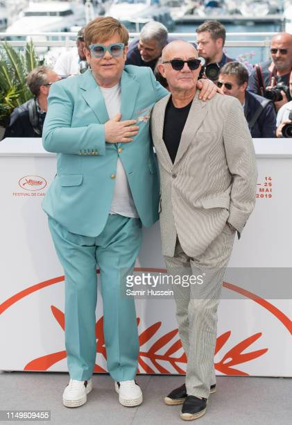 Elton John and Bernie Taupin attend the photocall for Rocketman during the 72nd annual Cannes Film Festival on May 16 2019 in Cannes France
