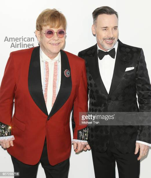 Elton John and David Furnish arrive to the 26th Annual Elton John AIDS Foundation's Academy Awards Viewing Party held at West Hollywood Park on March...