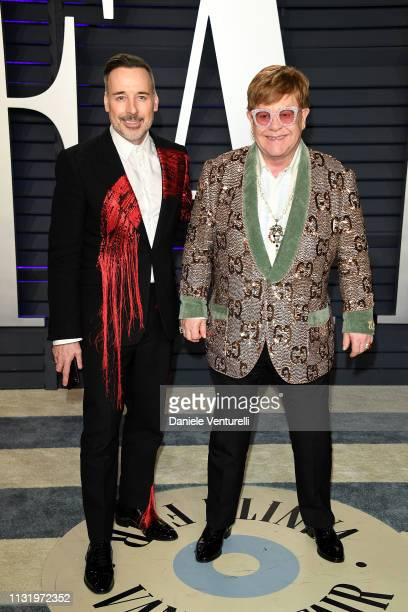 Elton John and David Furnish attend 2019 Vanity Fair Oscar Party Hosted By Radhika Jones Arrivals at Wallis Annenberg Center for the Performing Arts...