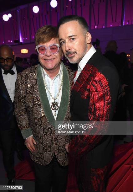Elton John and David Furnish attend the 2019 Vanity Fair Oscar Party hosted by Radhika Jones at Wallis Annenberg Center for the Performing Arts on...