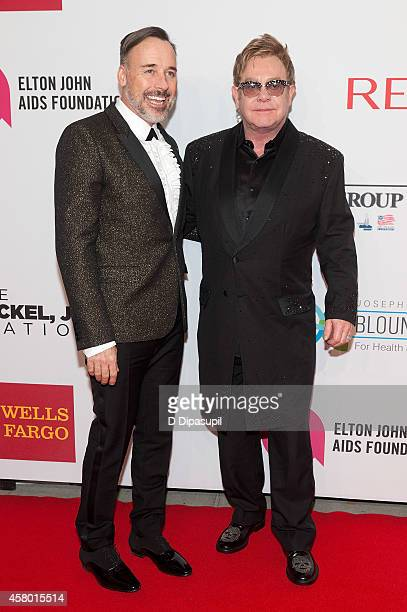 Elton John and David Furnish attend the Elton John AIDS Foundation's 13th Annual An Enduring Vision Benefit at Cipriani Wall Street on October 28,...
