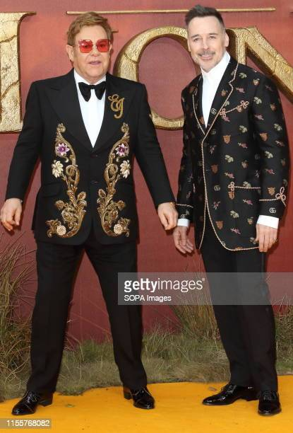 Elton John and David Furnish attend the European Premiere of Disney's The Lion King at the Odeon Luxe cinema Leicester Square in London