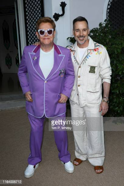 "Elton John and David Furnish attend the first ""Midsummer Party"" to raise funds for the Elton John Aids Foundation at the Villa Dorane on July 24 2019..."