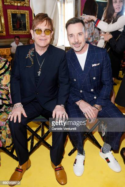 Elton John and David Furnish attend the Gucci Cruise 2018 fashion show at Palazzo Pitti on May 29 2017 in Florence Italy