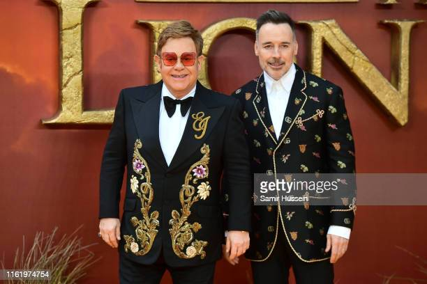 """Elton John and David Furnish attend """"The Lion King"""" European Premiere at Leicester Square on July 14, 2019 in London, England."""